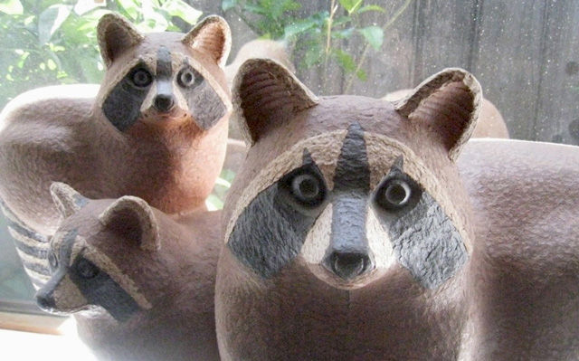 ceramic sculpture of a raccoon family by Betty Davenport Ford