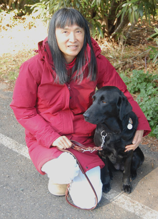 Carolyn Wing Greenlee with her black Lab guide dog Hedy